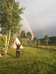 Price, quite happy about the double rainbow