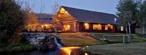Evening view of a lodge at Goosewing dude ranch