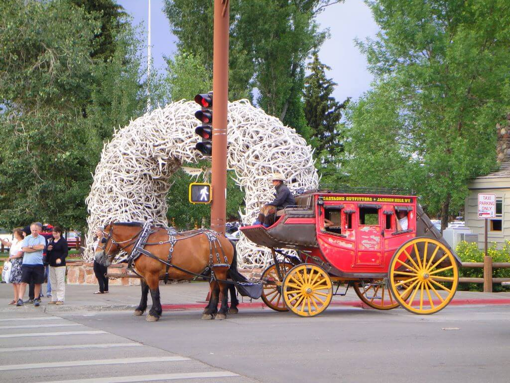 Horse drawn carriage tours circle Town Square in Jackson, Wyoming.