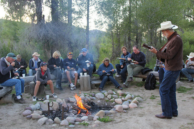 Highlights of a Jackson Hole family vacation at a dude ranch includes a campfire with smores and music.