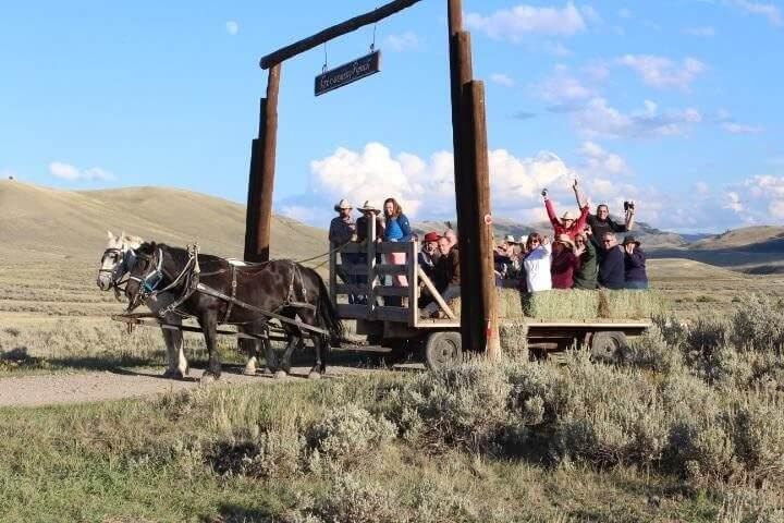 What makes a Jackson Hole family vacation? Start with a sunset hay ride pulled by draft horses.