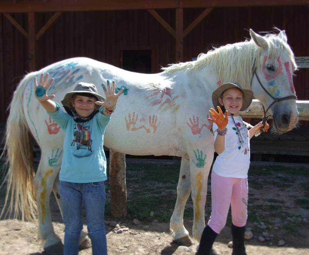 Little kids will love finger painting the horses during a family reunion at Goosewing Ranch in Wyoming.