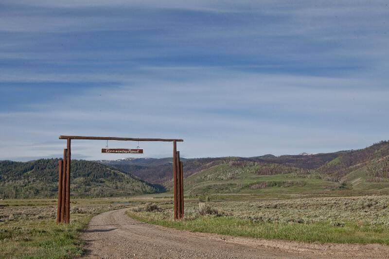 Jackson Hole, Wyoming is home to Jackson and also places on the road less traveled by such as Goosewing Ranch | Our entrance along the road less traveled.