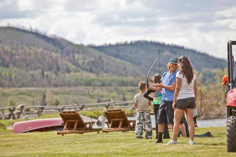 Older kids will have their hands full with archery, skeet shooting, and UTVs instead of cell phones and tablets while on a family reunion at Goosewing Ranch.
