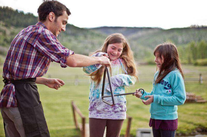 Kids get involved in all aspects of ranch life during their family reunion vacation in Wyoming.