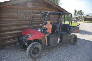 Young guest prepares for and adventure on his UTV at Goosewing Ranch