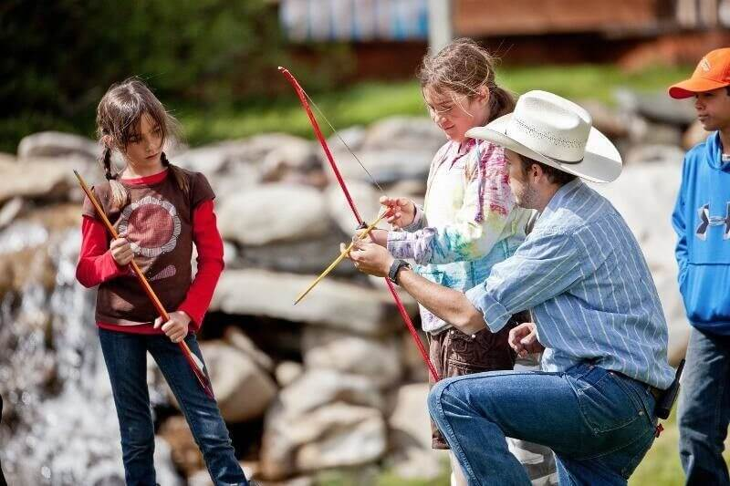 Jackson Hole Summer Jobs | Our activities are diverse and we pride ourselves on great employees, like this one teaching archery.