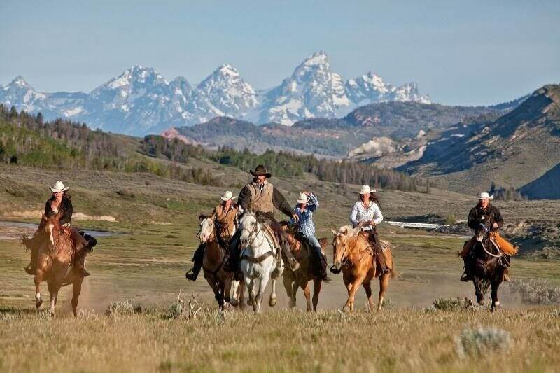 Dude ranch memories are sure to last a lifetime, so why not share them with others? Like this trail ride with vistas of the Grand Tetons.