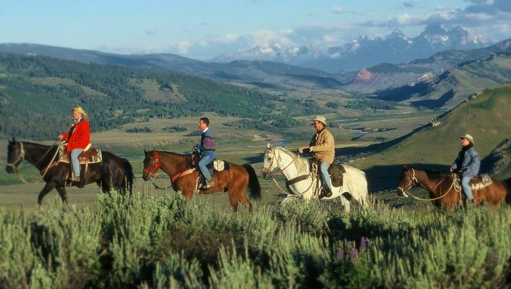 Horseback Riding in Jackson Hole | Grand Teton views as trail rides meander through Goosewing Ranch property and beyond in neighboring state parks.