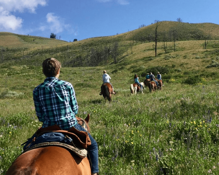 Jackson Hole vacation | Count on plenty of horseback rides and varied trails every day at the Goosewing Rendezvous glamping camp.