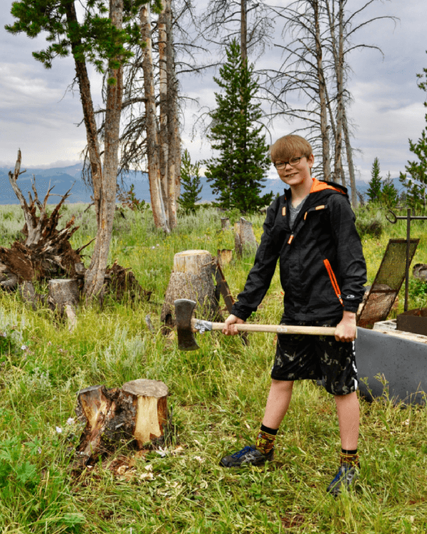 Jackson Hole vacation | Try a hand at cutting wood with an axe.