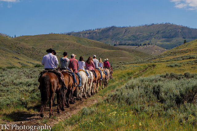 Single file is the way to go on a trail ride in Jackson Hole at Goosewing Ranch.