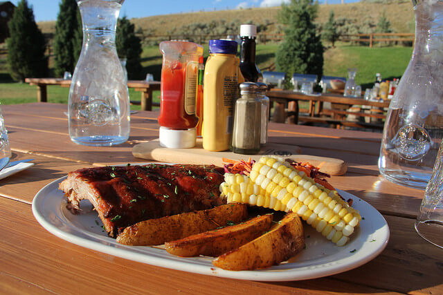 BBQ ribs served up family style are one of the 8 Reasons to Take a Dude Ranch Vacation.