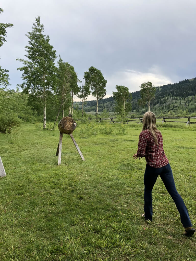 trying new activities like axe throwing is unique experience at a dude ranch, making it one of the 8 Reasons to Take a Dude Ranch Vacation.