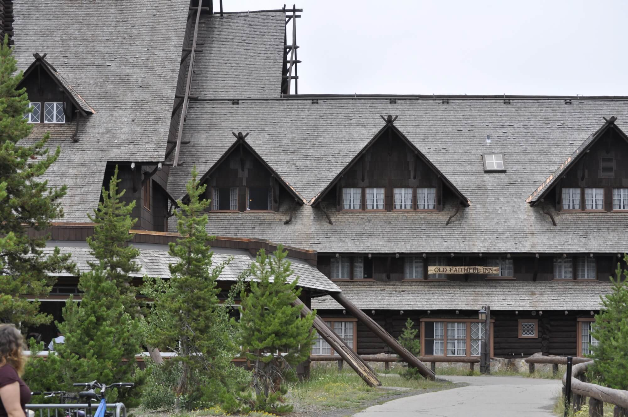 Old Faithful Inn is one of the best lodges in Yellowstone National Park; staying inside the park is one of our Yellowstone tips.