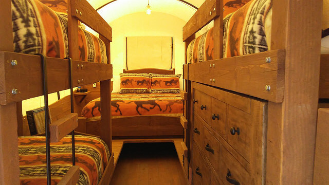 Jackson Hole glamping at Goosewing Ranch offers two types of accommodations, including this family wagon with twin bunks and a king bed.